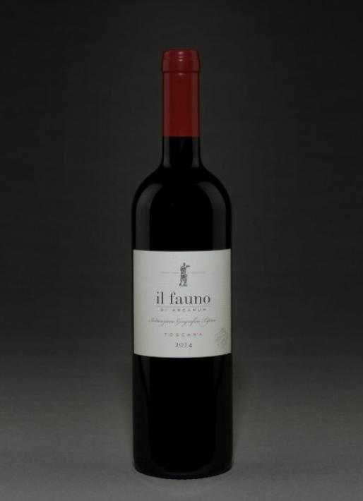 Bottle of red wine against a dark background